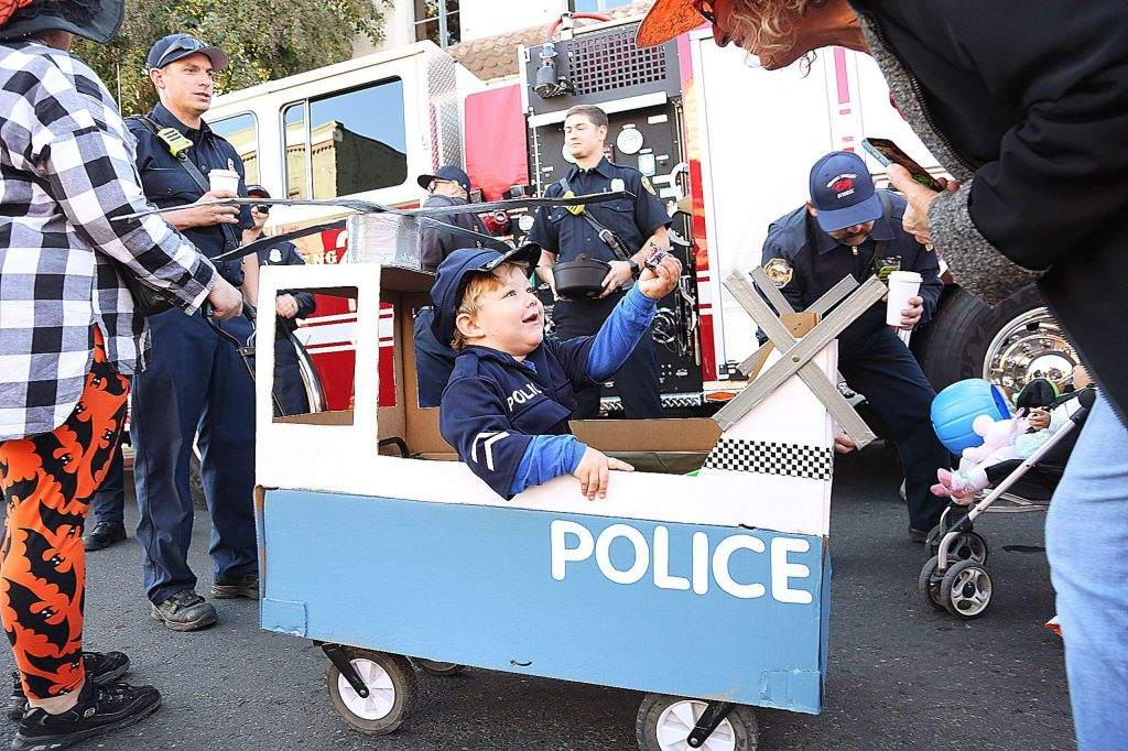 Two-year-old Garrison Leach wanted to be a police officer helicopter pilot, so his parents helped make that happen for this year's Downtown Grass Valley Association's Safe Trick-Or-Treat event. Hundreds of kids and their families took to the streets for the free candy passed out by area business owners, firefighters and others.