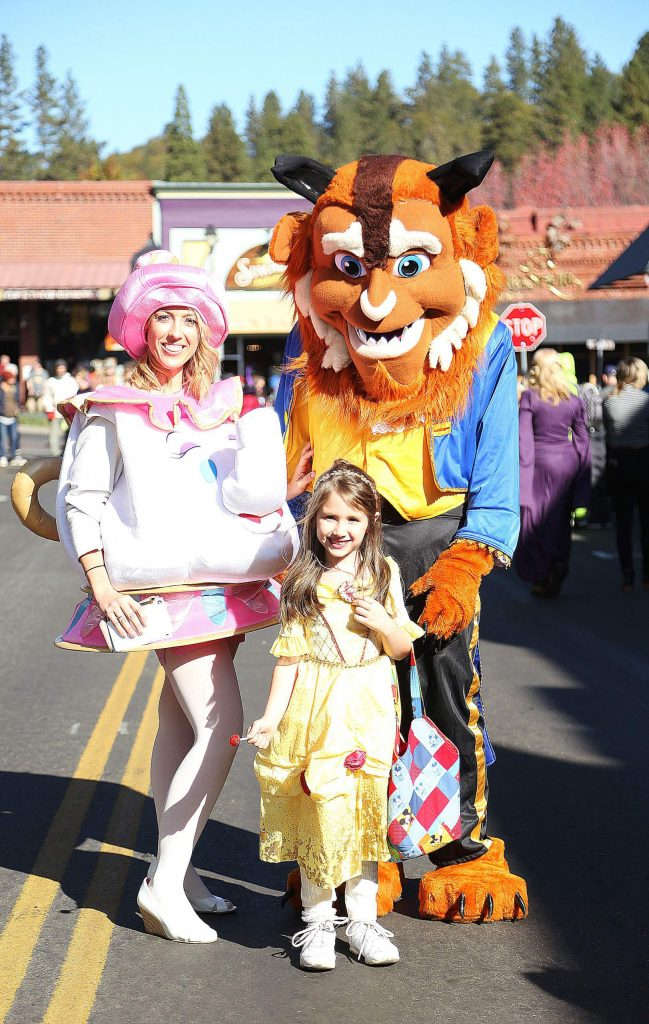 Brookelyn Stafford as Belle, with parents Lee and Christine Stafford made the cute Beauty and the Beast family.
