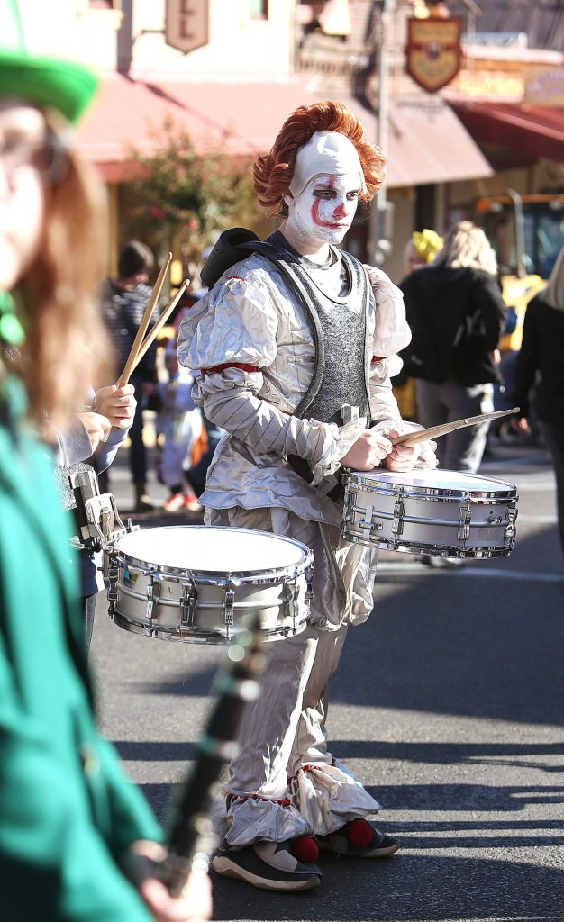 Lyman Gilmore drummer Albert Wahl sports a Pennywise the clown costume while playing with the band in the streets of downtown Grass Valley.