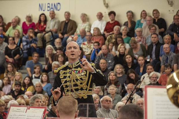 Colonel Jason K. Fettig, 28th director of the U.S. Marine Band, directs the band Friday.