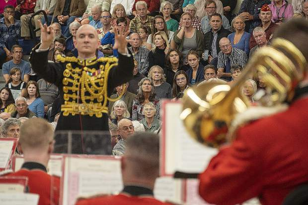 Colonel Jason K. Fettig, the 28th director of the United States Marine Band, directs before a capacity crowd during Friday's performance of