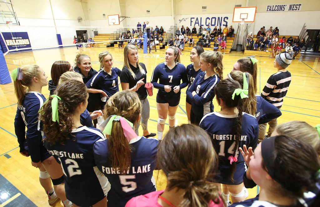 Forest Lake Christian varsity girls volleyball head coach Shannon Syfstestad talk to her team before the third set of the night Thursday at home.