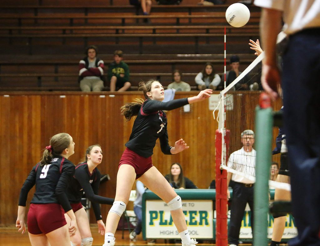Bear River junior Sydney Franks (7) sends a lob over the net towards the Bruins' Venture Academy opponents during their first round playoff win at Placer High School Tuesday evening.