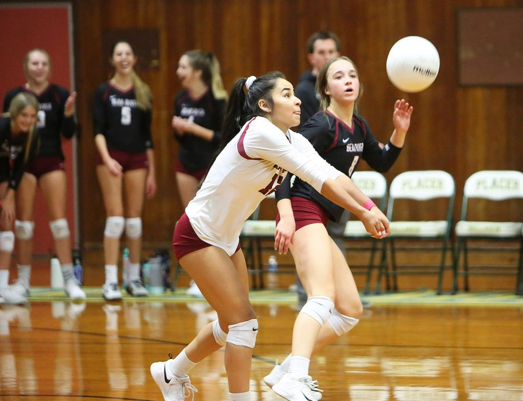 Bear River senior Julie Bristol (12) bumps the ball from a Venture Academy serve during Tuesday's three set first round playoff victory for the Bruins.