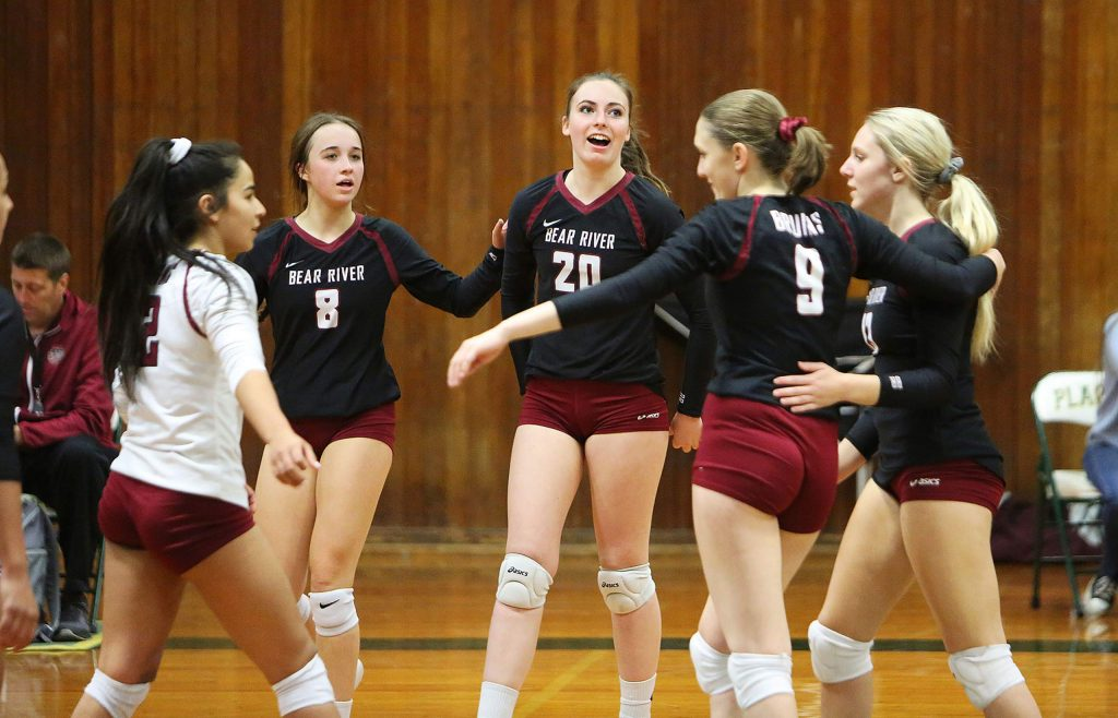 The Bear River varsity girls volleyball team congratulates one another after winning a set over Venture Academy during their first round playoff win Tuesday evening at Placer High School.