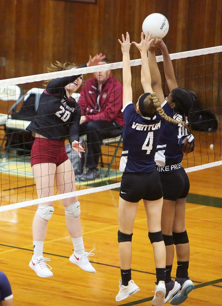 """Bear River 5'10"""" senior Gracie Terrell (20) sends a forceful spike over the net during Tuesday's playoff win over Venture Academy."""