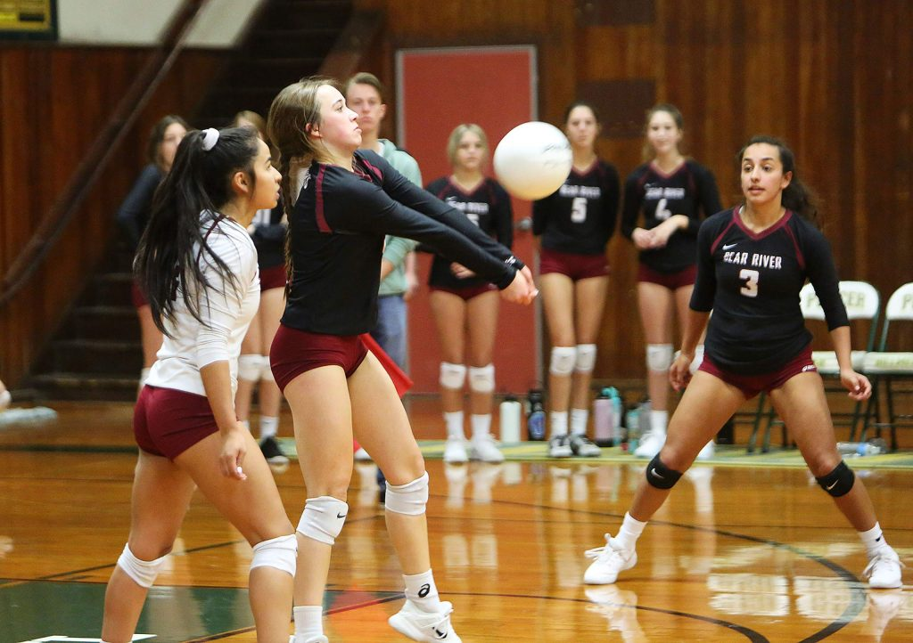 Bear River junior Ashley M Ray (8) bumps the ball for her team mates after receiving a Venture Academy serve.