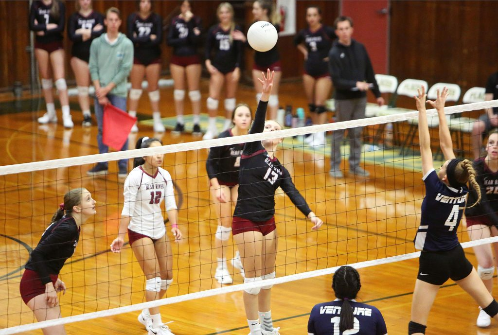 Bear River junior Summer Huntley (13) fakes her Venture Academy opponents out with a lob in the opposite direction of the defense during Tuesday's first round playoff win in three sets.