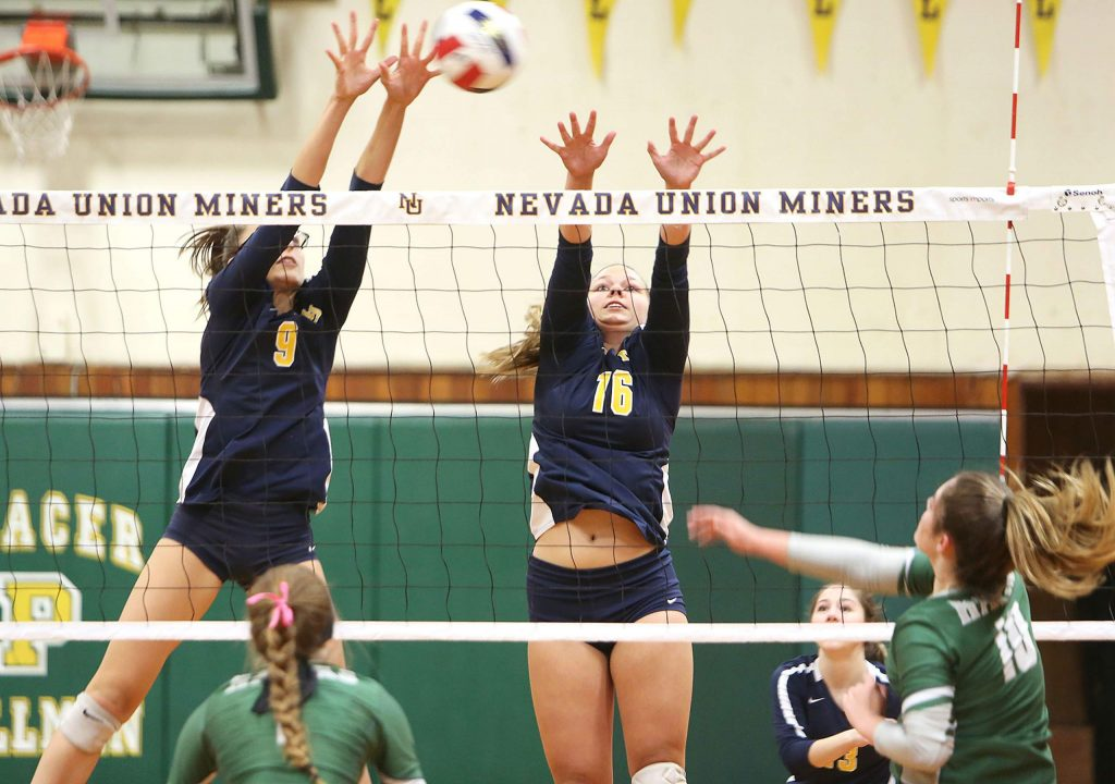 Nevada Union's Kailee McLaughlin (9) and Dani Gil (16) go up for a block attempt against Liberty Ranch.