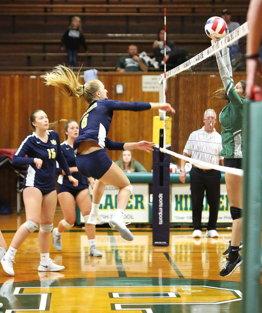 Nevada Union's Kayda Kinch (6) sends a forceful spike over the net during the Miners' win in three straight sets over Liberty Ranch.