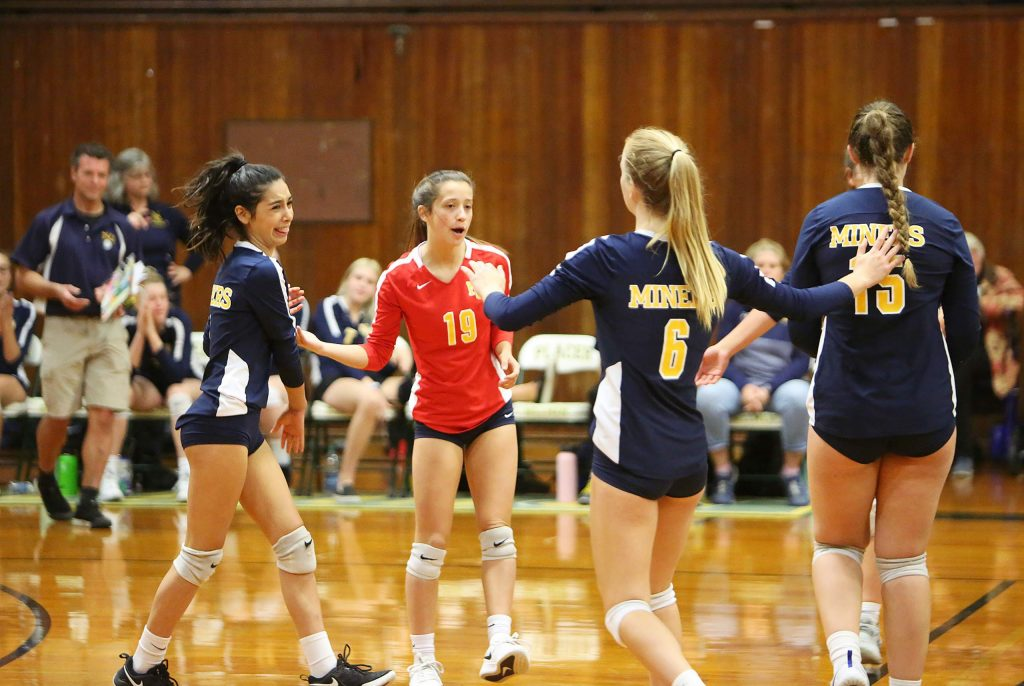The Nevada Union Miners girls volleyball team congratulates one another after scoring a point over Liberty Ranch.