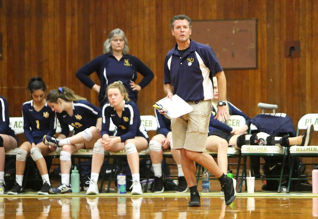 Nevada Union girls volleyball head coach Chrys Dudek watches his team as they battle back from a third set deficit before winning Tuesday's first round playoff match against Liberty Ranch.