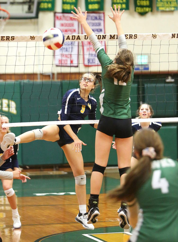Nevada Union's Kailee McLaughlin (9) watches as her spike passes Liberty Ranch defenders during Tuesday's first round playoff win in Auburn.