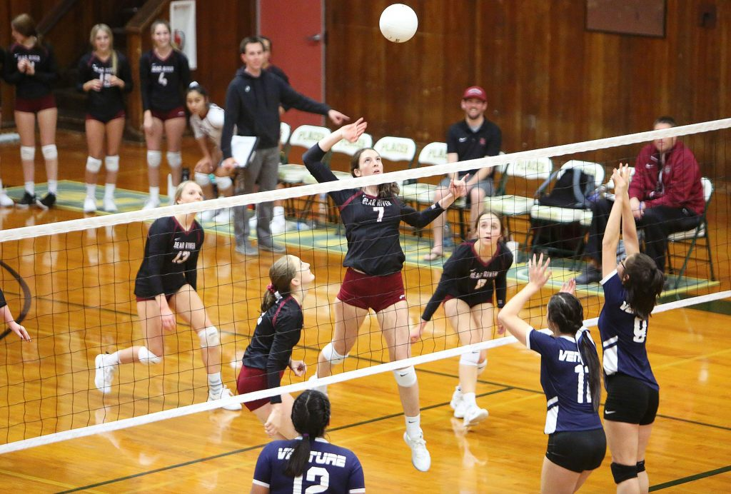 """Bear River 5'10"""" junior Sydney Franks (7) readies to spike a ball over the net towards the Bruins' Venture Academy opponents during their first round playoff win at Placer High School Tuesday evening."""