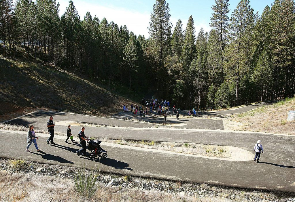 The long awaited completion of the Wolf Creek Trail was celebrated Saturday morning with a ribbon cutting ceremony and trick-or-treat hosted by members of the city of Grass Valley, Bear Yuba Land Trust and others. Pavement covers the more than 1-mile trail, including the switchback access road created in the space of the Little Wolf Creek sinkhole which formed here during the rain events of late 2016 and early 2017.