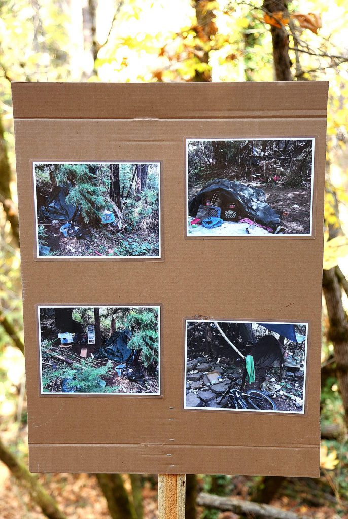 Pictures of homeless encampments cleaned up from the area showed trail users part of the impetus behind the creation of the Wolf Creek Trail.