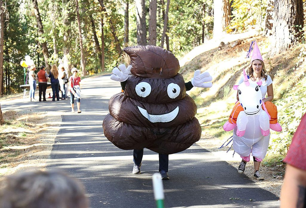 Folks donned their Halloween costumes during the grand opening of the Wolf Creek Trail.