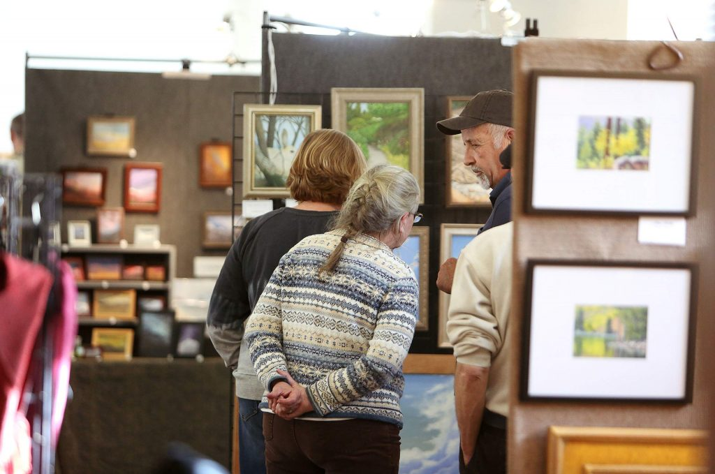 Many showed up to view and purchase the art from sixteen area artists for the growing annual Holiday Show and Sale event put on by the Nevada County Plein Air Painters over the weekend at the Nevada City Veterans Hall.