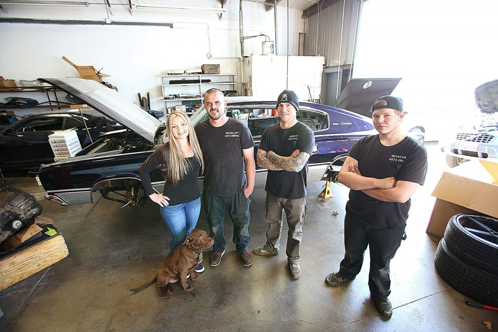 Crystal Short, Matt Milhous, Jeremy Norton, and Daimiyon Ralston of Nevada City Auto Service stand in their new garage off of Charles Drive near the Nevada County Airport.