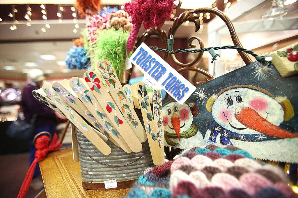Toaster tongs, knitted mittens, and painted holiday decorations were part of Jackie Milhous' Creations by Jackie booth which featured ceramics, cards, and hand painted glass, wood, and tin.
