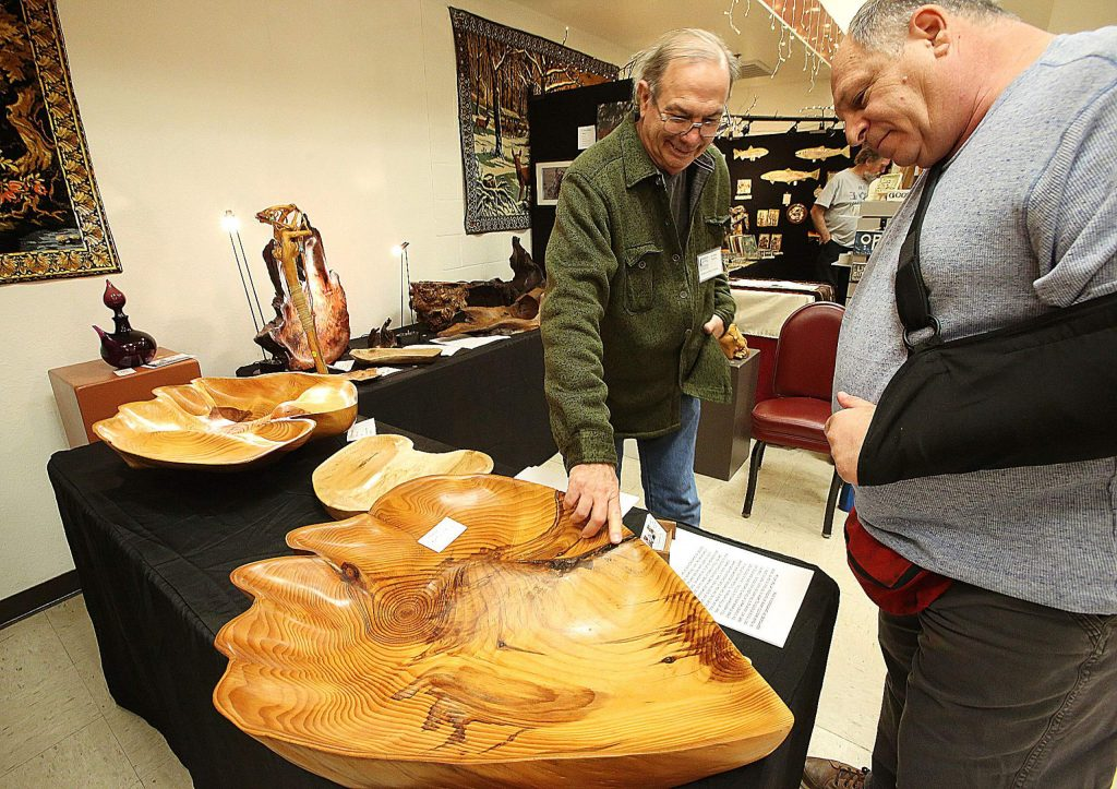 """Woodworker R. Dean Nyberg shows off a piece he titled """"With Heart"""" that he had for sale during the weekend's Banner Mountain Artisans annual Holiday Show and Sale held at the Nevada City Elks Lodge."""