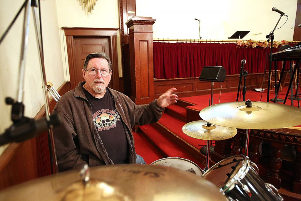 Church drummer Bruce Bellows was also an extra during the filming of The Christmas Card. He was also a drummer in the movie but was positioned on the stage.