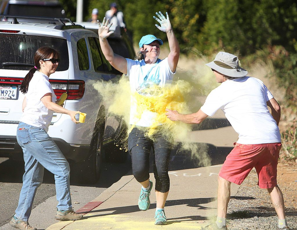 Participants had the option of running the 5k or 2.5k courses which twisted through the woods around Nevada Union High School where color agents powdered them in color.