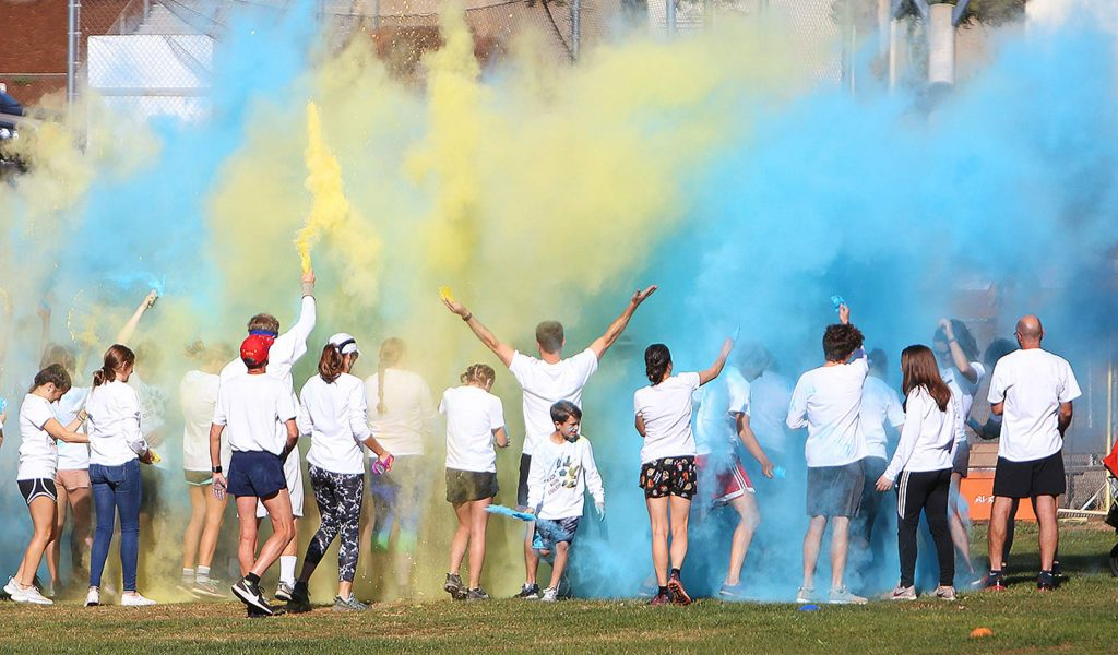 The Nevada Union girls soccer team started their second annual Kick Run Color 5k with a cloud of color Saturday at the Nevada Union High School lower fields. The event is held to raise money to help them buy winter apparel.