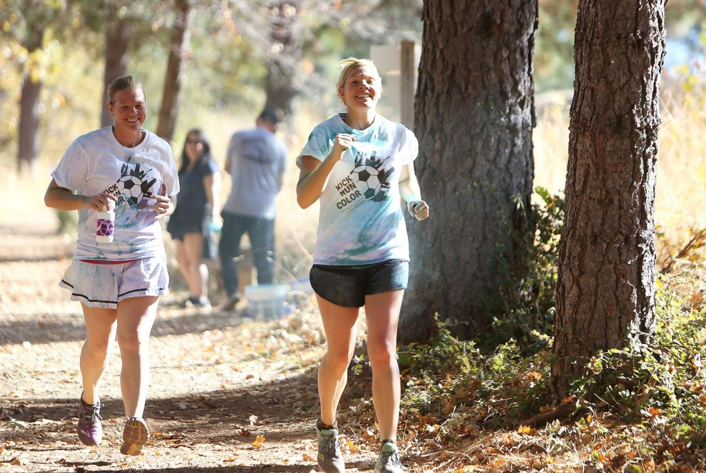A pair of runners keep pace with one another while taking part in the Kick Run Color walk/run 5k at Nevada Union High School.