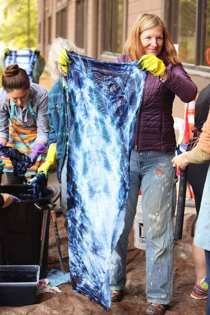 Cara Meinholz holds up her indigo dyed creation.