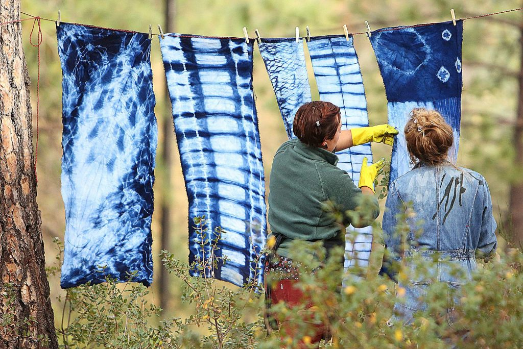 It was everything indigo Saturday at the Curious Forge maker space and workshop area off of Bitney Springs Road where Eileen Holzer and Audra Ogden led an indigo dye class using the Japanese Shibori technique. Curious Forge's workshops are open to the public with a discount given to members of the maker space and range from plasma cutting, welding, jewelry making, sculpture, textiles and more.