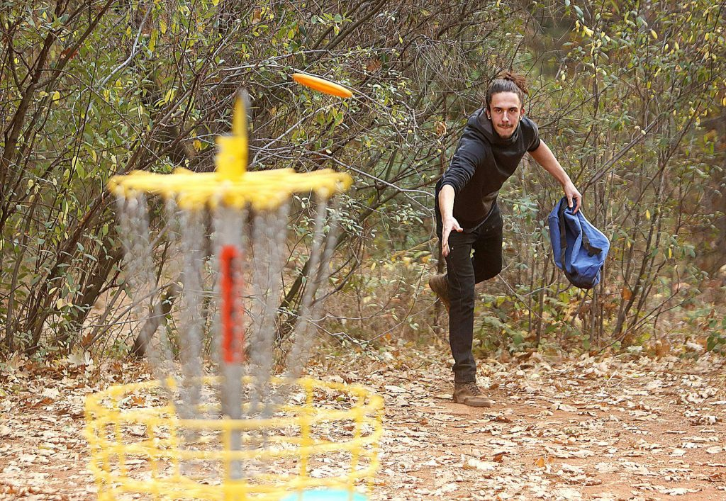 Penn Valley's Tiger Hitcher tosses a disc golf toward the basket Wednesday afternoon at Grass Valley's Condon Park. Grass Valley has a rich disc golf pedigree, boasting three Professional Disc Golf Association Hall of Famers and 2018 professional disc golf world champion Gregg Barsby.