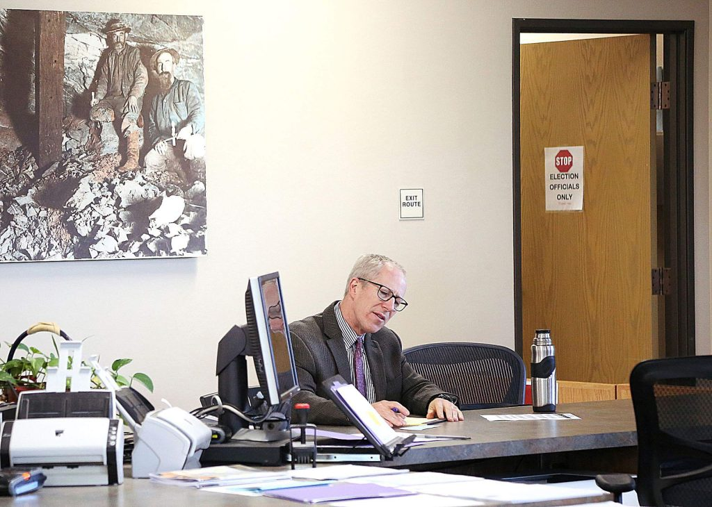 Nevada County Superior Court judge Robert Tice-Raskin fills out paperwork regarding his re-election bid Thursday afternoon at the Rood Government Center in Nevada City.