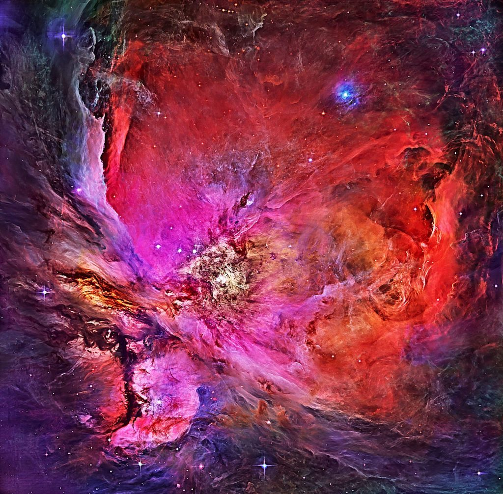Baby stars make gas and dust glow in the womb of the hunter's dagger of Orion.