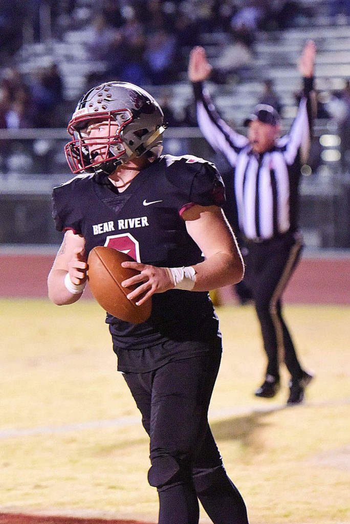 Bear River's Ryder Kiggins scores a touchdown during a playoff game against Highlands Friday night.