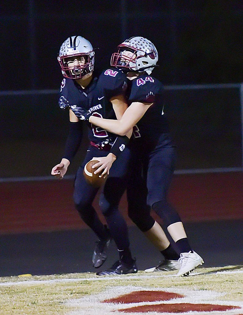 Bear River's COlton Jenkins (2) and Gavin Jackson celebrate a touchdown during their playoff win over Highlands.