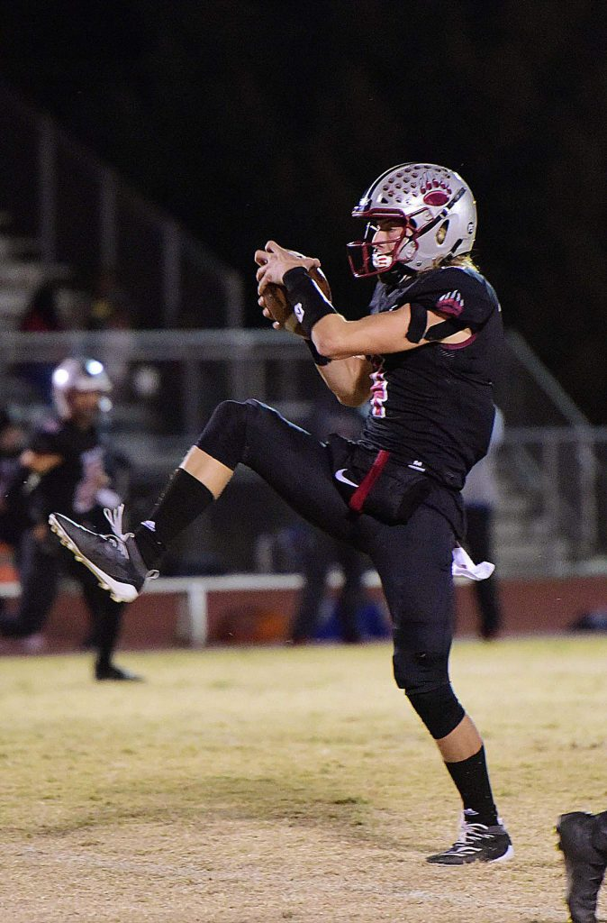 Bear River's Tre Maronic intercepts a pass during a playoff game against Highlands Friday.