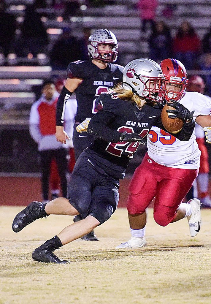 Bear River's Jacob Ayestaran runs the ball during a playoff game against Highlands Friday. The Bruins won, 64-26.