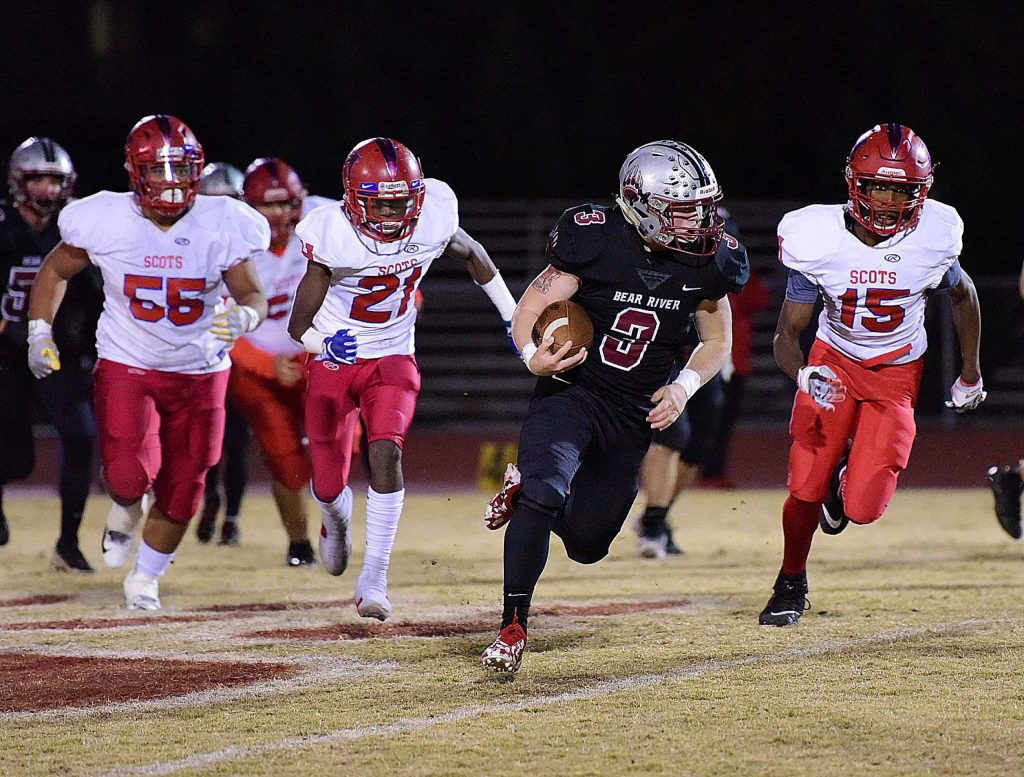 Bear River's Ryder Kiggins runs the ball during a playoff game against Highlands Friday. The Bruins won, 64-26.