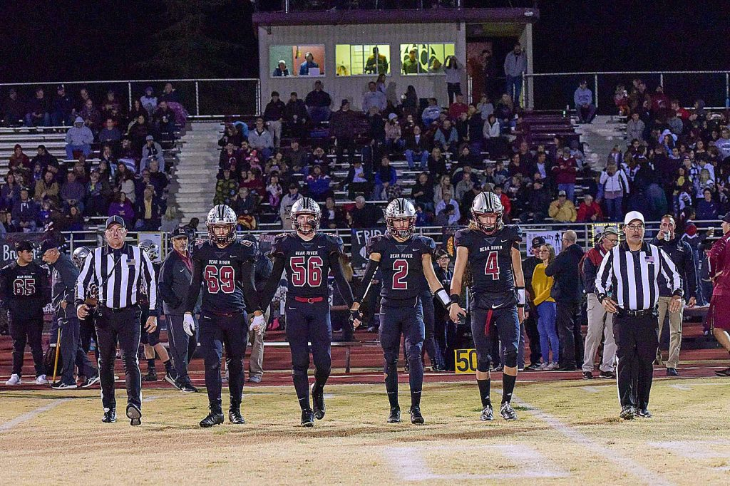 Bear River team captains (from left) Caleb Hurst, Warren Davis, Colton Jenkins and Tre Maronic walk to midfield for the coin toss ahead of a playoff game against Highlands.