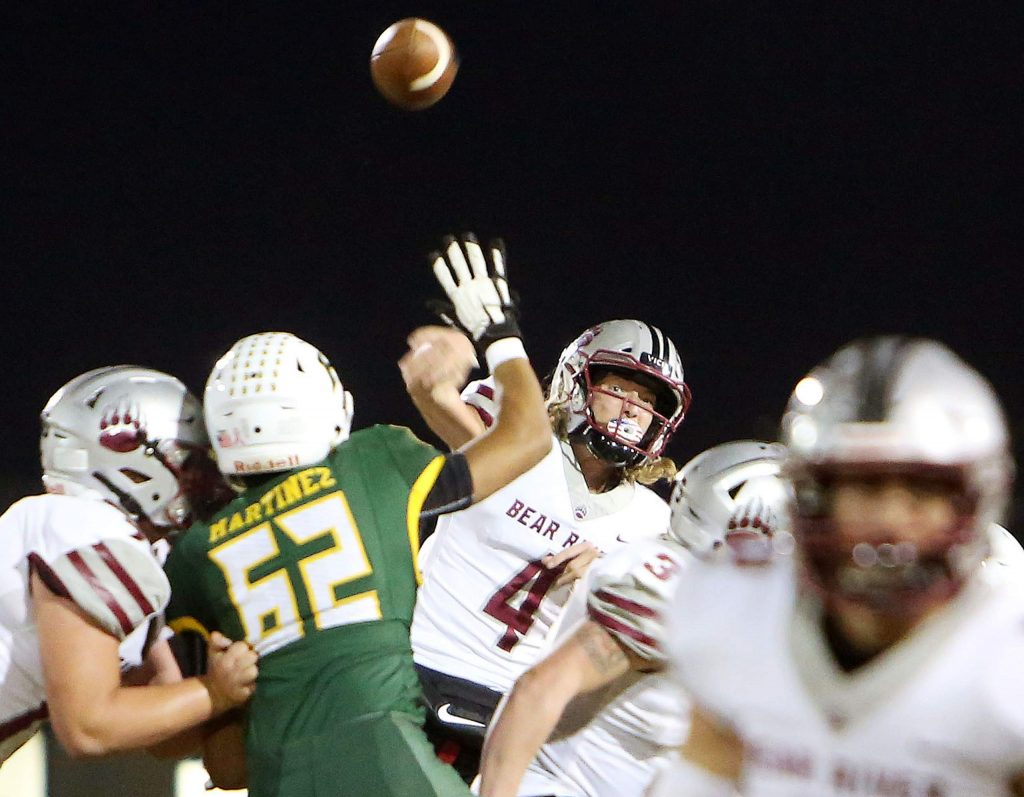 Bear River quarterback Tre Maronic (4) lets a pass fly during Friday night's Sac Joaquin Section D VI second round playoff game against the Hilmar Yellowjackets.