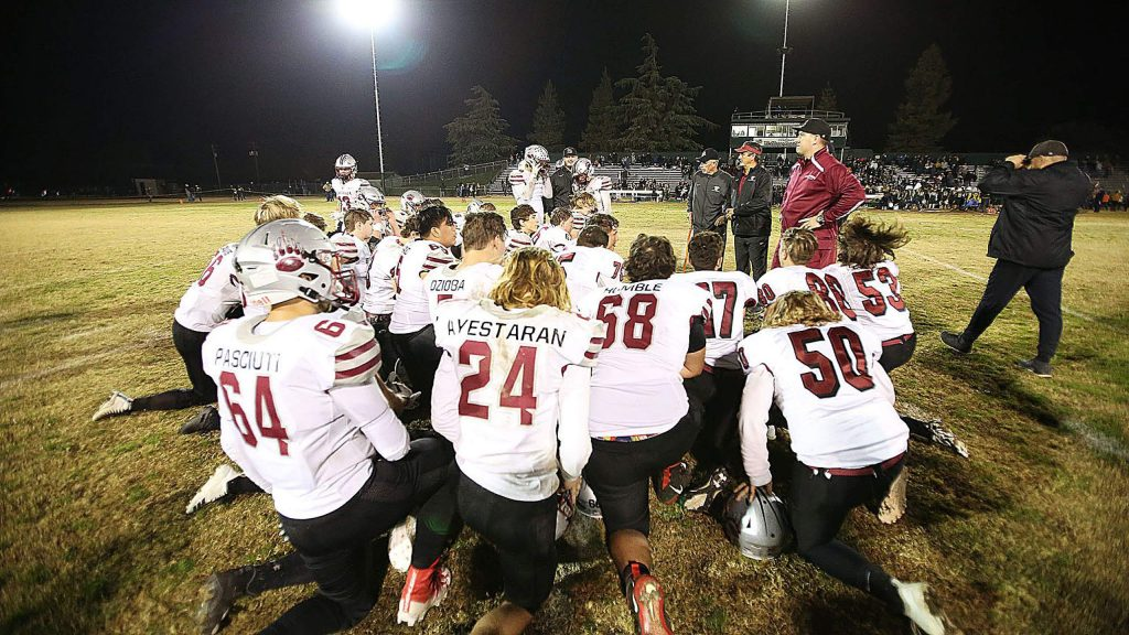 The 2019 Bear River Bruins varsity football team comes together on the football field one last time following their second round playoff loss to the Hilmar Yellowjackets Friday in Merced County.