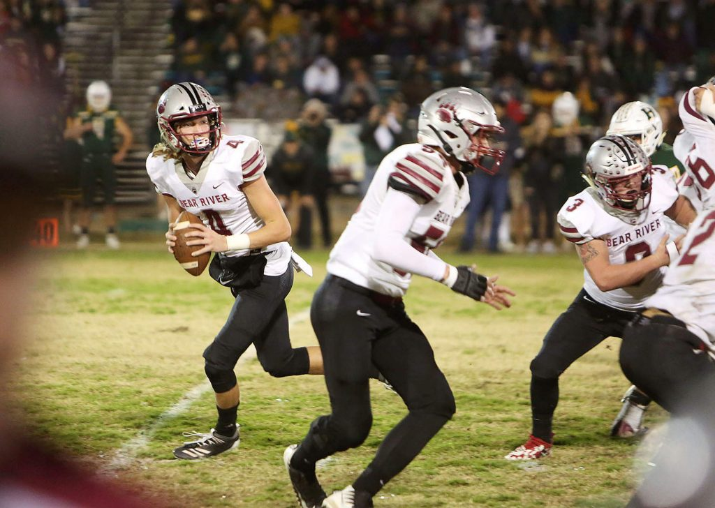 Bear River senior and starting quarterback Tre Maronic (4) pulls back to make a pass for a first down against the Hilmar Yellowjackets during Friday night's Sac Joaquin Section D VI second round playoff loss.