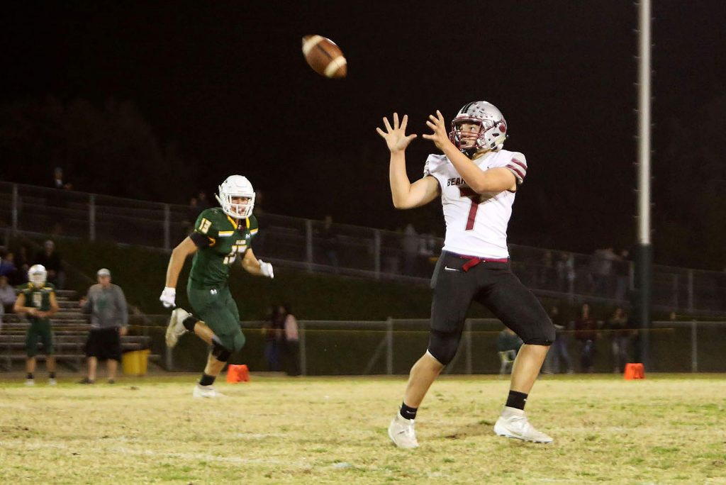 Tyler Dzoiba (7) catches a pass from quarterback Tre Maronic during one of their offensive marches down the field against the Yellowjackets Friday in Hilmar.