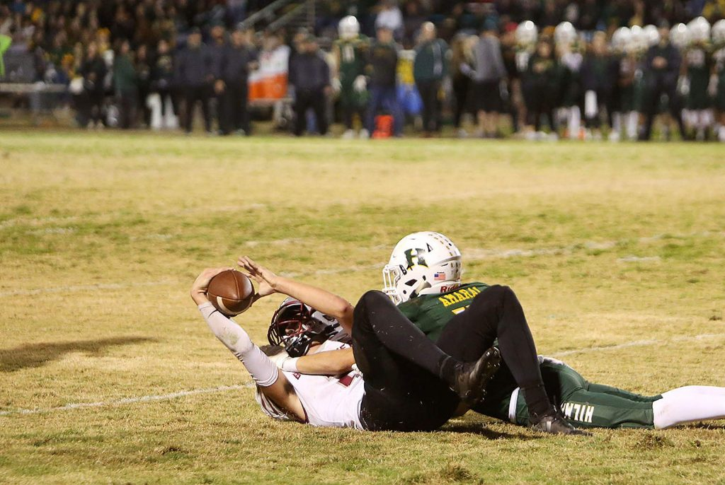 Bear River receiver Colton Jenkins (2) holds the all up to signify his catch under pressure from Hilmar defender Stephen Amaral (14) during a scoring drive for the Bruins during Friday's second round Sac Joaquin Division VI playoff game against the Yellowjackets.