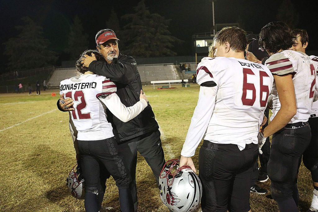 Bear River co-head coach Scott Savoie hugs his players after an emotional loss Friday night to the Hilmar Yellowjackets in the Sac Joaquin Section D VI second round playoff.