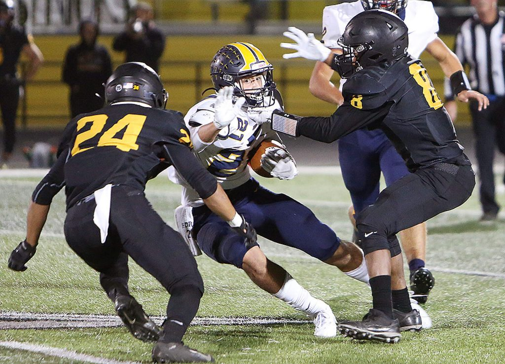 Nevada Union runningback Jaxon Horne (21) was stymied on play after play by the Rio Linda Knights' defense.