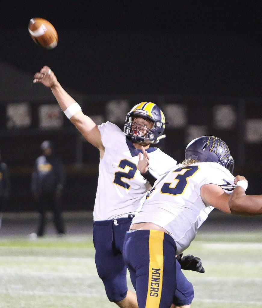 Nevada Union varsity quarterback, sophomore Gabriel Baker (2), fires a pass during the Miners' loss Friday to the Rio Linda Knights.