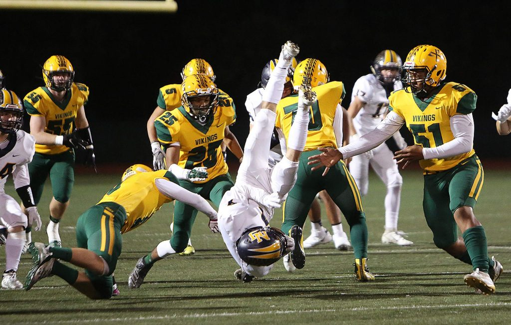 Nevada Union ball carrier A.J. Meyer (4) gets upended during the first carry of the game for the Miners.