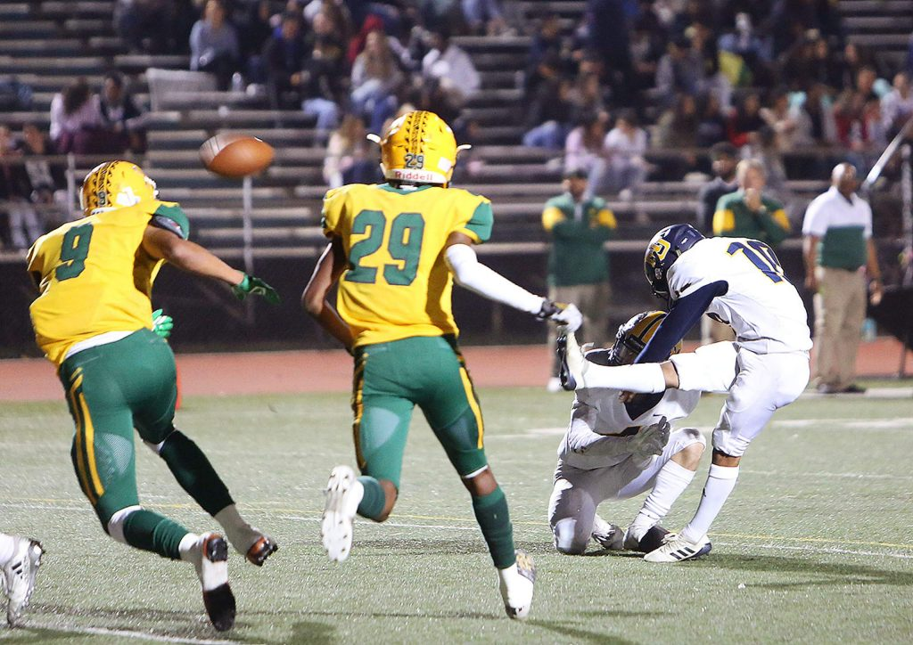 Nevada Union kicker Moises Tovar (10) kicks in one of his extra points for the night during Friday's playoff loss to the Vanden Vikings.